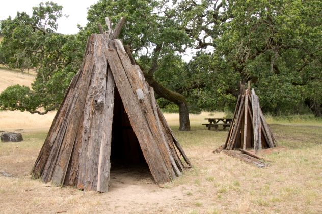 A reconstructed Coast Miwok village at Olompali. The structure on the left was used as shelter and the structure on the left, for food storage.