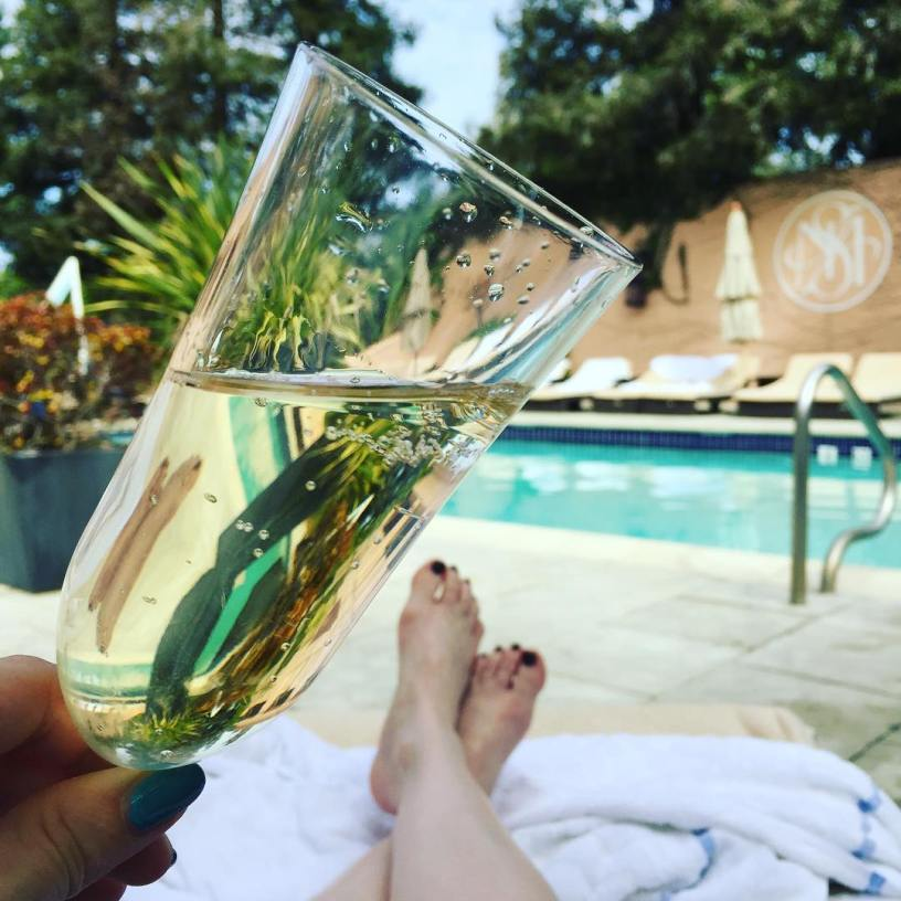 Drinking bubbles at the pool at Fairmont Sonoma Mission Inn's Willow Stream Spa